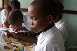 boy_reading_in_Tanzania_library
