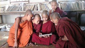 Buddhist Monks reading from a tablet at Tharsi Quarter Library