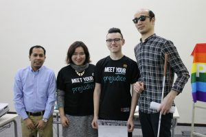 Four participants and Organisers from the Human Library Pose together